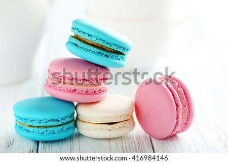Tasty french macarons on a blue wooden table