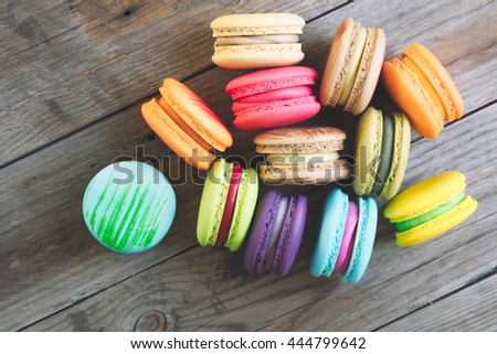 Tasty french macarons on a wooden table with vintage color tone, Macarons  is a French sweet meringue-based