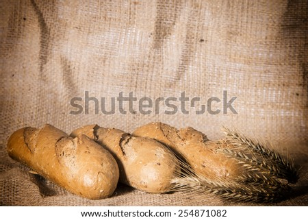tasty fresh bread with ears of rye - stock photo