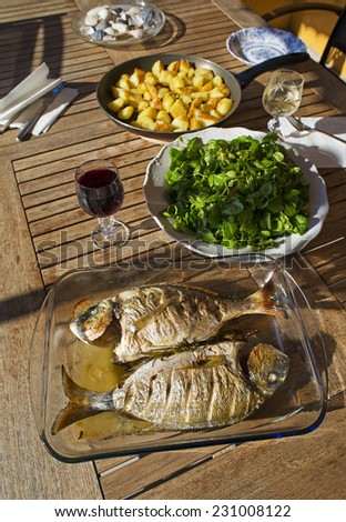 Tasty fresh sea fish for lunch outdoor. Culinary healthy cooking. - stock photo