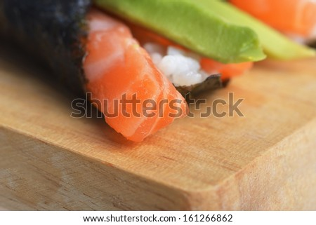 tasty fresh sushi cone on wooden plate