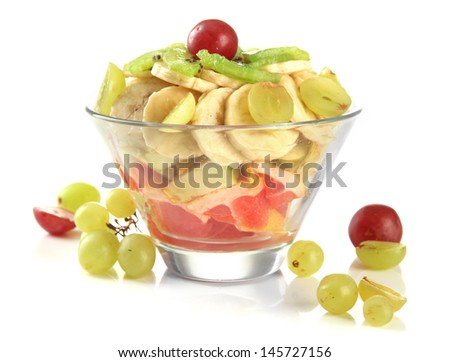 Tasty fruit salad in glass bowl, isolated on white - stock photo