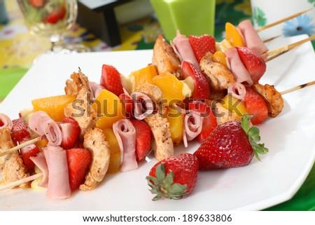 Tasty fruit skewers. Colorful skewers of chicken, strawberries and ...