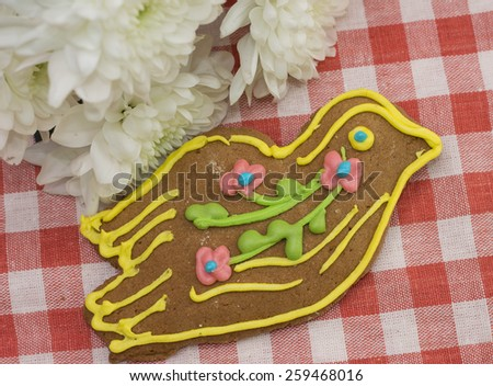 Tasty gingerbread in form of bird as gift on March 8 - stock photo