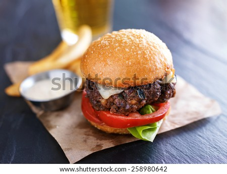tasty gourmet burger with french fries and sauce - stock photo