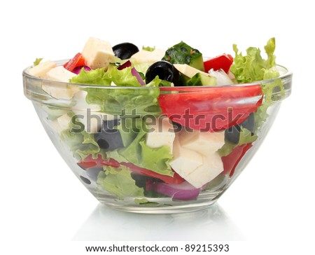 Tasty greek salad in transparent bowl isolated on white - stock photo