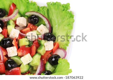 Tasty greek salad. Isolated on a white background.
