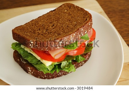 Tasty ham and cheese sandwich. Shallow depth of field. - stock photo