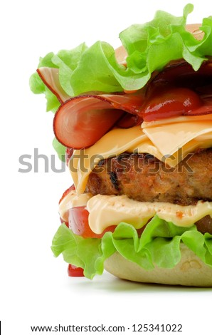 Tasty Hamburger with Bacon, Beef, Cheese, Tomato, Lettuce, Mayonnaise and Ketchup closeup on white background - stock photo