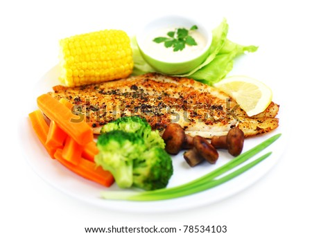 Tasty healthy fish fillet with steamed vegetables, isolated on white background - stock photo