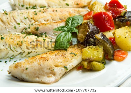 Tasty healthy fish fillet with vegetables - stock photo