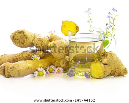 Tasty herbal tea or infusion of fresh ginger and herbs like Bellis prennis and Veronica, on a white background - stock photo