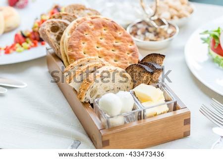Tasty Homemade Bread in Basket in the Restaurant, Breakfast Time - stock photo