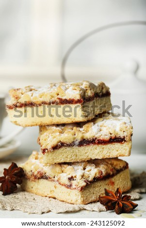 Tasty homemade pie and teapot, on wooden table - stock photo