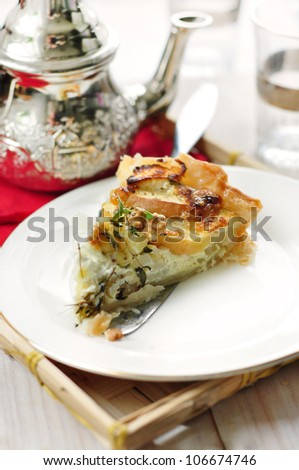 tasty homemade quiche with apples and soft goat cheese