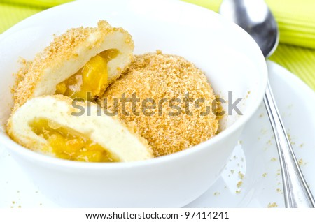 tasty hot apricot dumpling with white dishes - stock photo