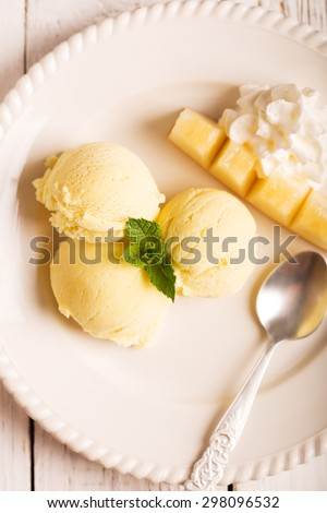 Tasty ice cream with mango and mint