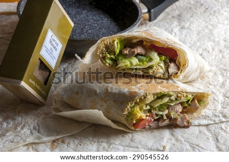 Tasty indian wrap with chicken meat and garam masala spices - stock photo