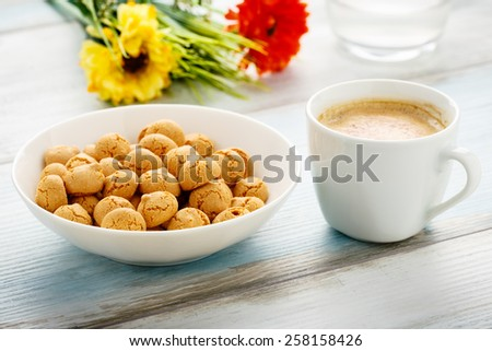 tasty italian amarettini and coffee - stock photo