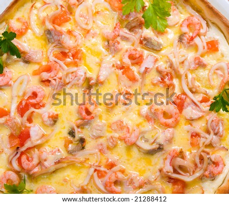 Tasty Italian pizza  on plate.Italian kitchen.seafoods,prawns