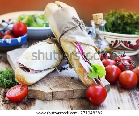 Tasty Italian Sandwiches with Ham, Green Lettuce and Radish Slices - stock photo