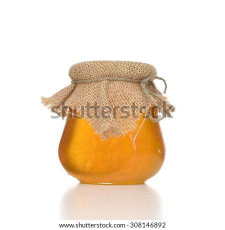 Tasty jar of jam or honey with blank text space isolated on white background - stock photo