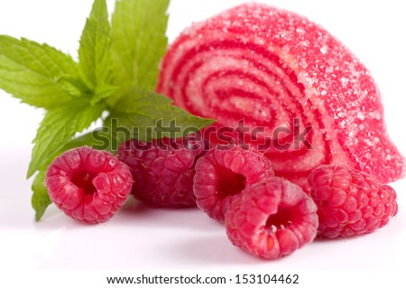 Tasty jelly candy with raspberry on the white - stock photo