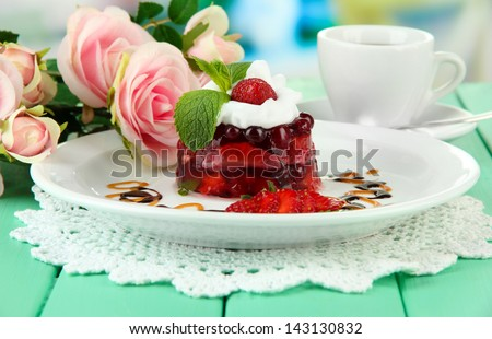 Tasty jelly dessert with fresh berries, on bright background - stock photo