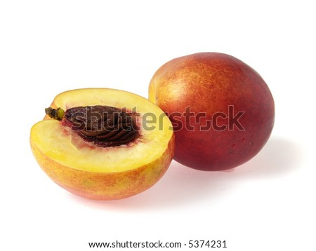 Tasty juicy nectarine and half on a white background with water droplets - stock photo