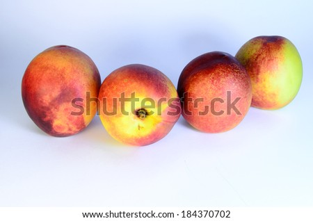 Tasty juicy peaches on a white background