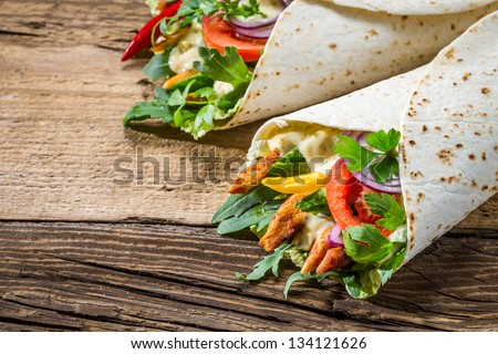 Tasty kebab with vegetables and chicken - stock photo