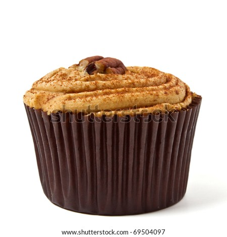 tasty looking Pecan and Caramel cup cake isolated on white. - stock photo