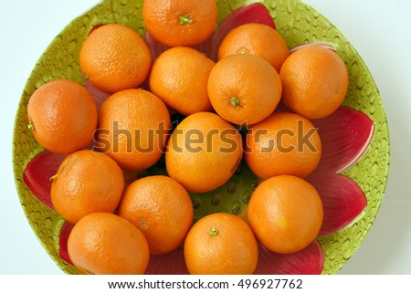 Tasty mandarines on color plate