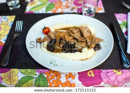 Tasty meal in a plate - stock photo