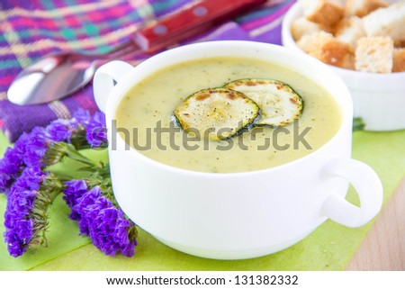 Tasty meal - Zucchini cream soup with croutons - stock photo