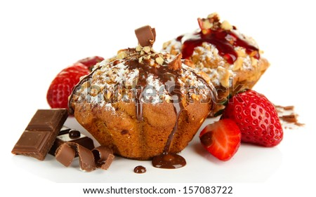 Tasty muffin cakes with strawberries and chocolate, isolated on white - stock photo
