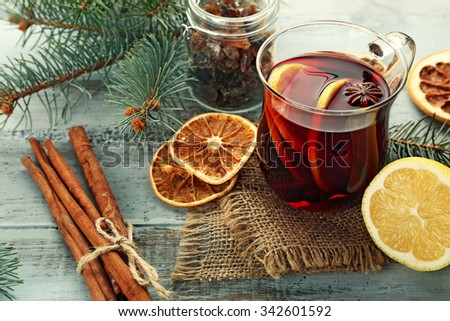 Tasty mulled wine and spices, on blue wooden background, close-up - stock photo
