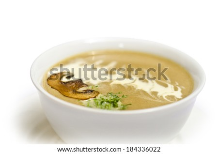 tasty mushroom cream soup with greens isolated on white background - stock photo