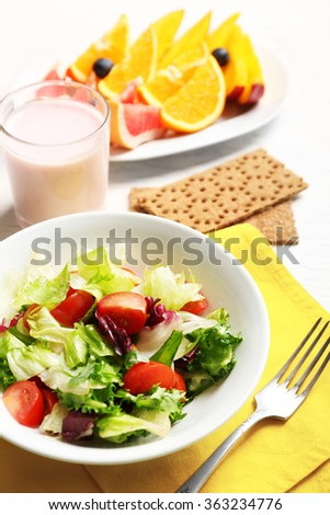 Tasty oatmeal and vegetable salad on wooden background. Healthy eating concept.  - stock photo