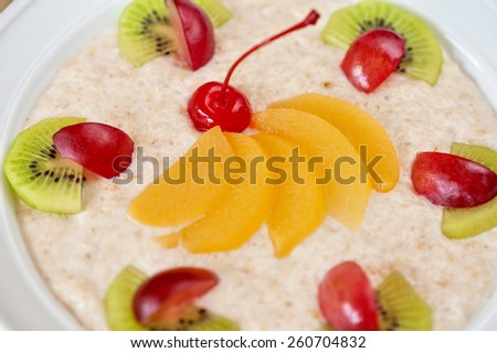 Tasty oatmeal with berries and fruits - stock photo