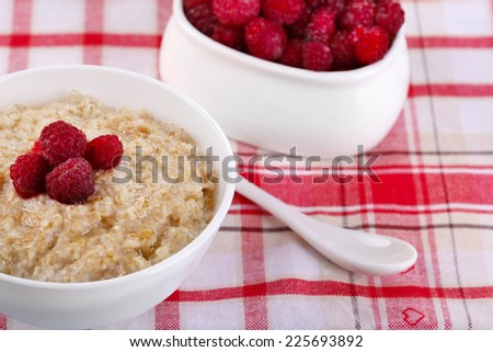 Tasty oatmeal with berries on napkin close-up - stock photo