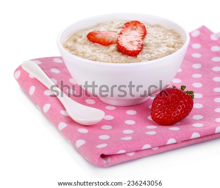Tasty oatmeal with berries on napkin isolated on white - stock photo