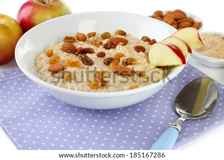 Tasty oatmeal with raisins and apples close up - stock photo