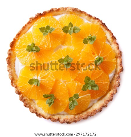 Tasty orange citrus tart with white cream and mint isolated on white background - stock photo
