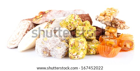 Tasty oriental sweets (Turkish delight), isolated on white - stock photo