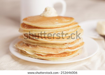 Tasty pancakes with sour cream