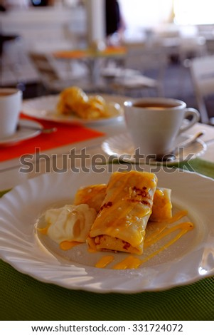 Tasty pancakes with syrup on the table, close up - stock photo