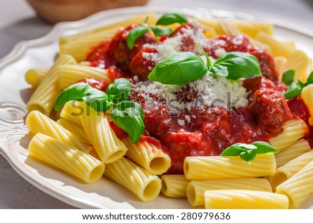Tasty pasta penne in the sunny kitchen - stock photo