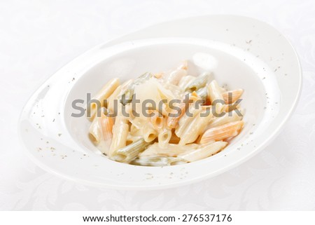 tasty pasta with cream and cheese  - stock photo