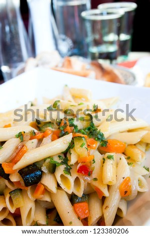 tasty pasta with roast ham on the table